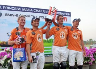 The victorious Thai Polo team raise the HRH Princess Maha Chakri Sirindhorn Cup after winning an exciting final at the BMW- B.Grimm Thai Polo Open.