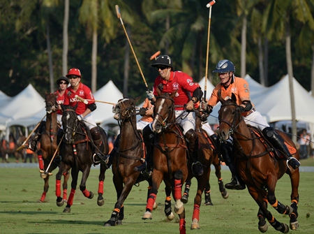 Thai Polo and AXUS fight for possession of the ball during the first half of the match.