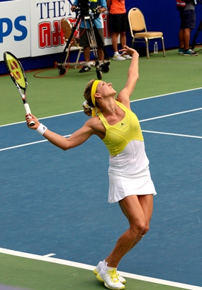 The graceful Kirilenko serves to Lisicki during the opening set.
