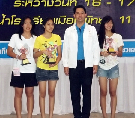 Winners in one of the junior female categories receive awards from Pattaya Mayor Ittipol Kunplome.