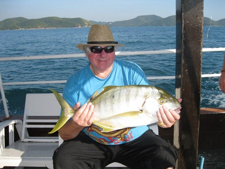 A happy angler with a 5kg trevally catch.