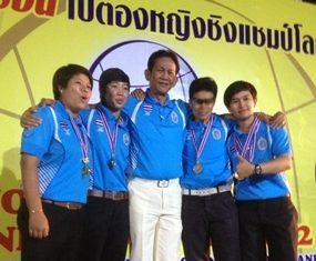 The victorious Thailand team pose with their coach after winning the 2nd Marathon Pentaque Women's Confederation Cup 2012.