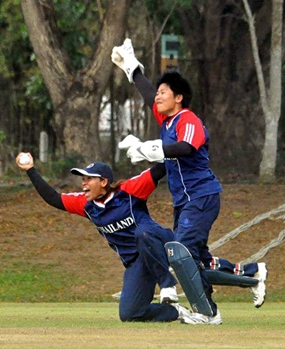 Thai players celebrate taking a wicket against China in the final.