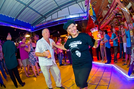 Eva Johnson (right) balances beer with some smart moves on the dance floor.