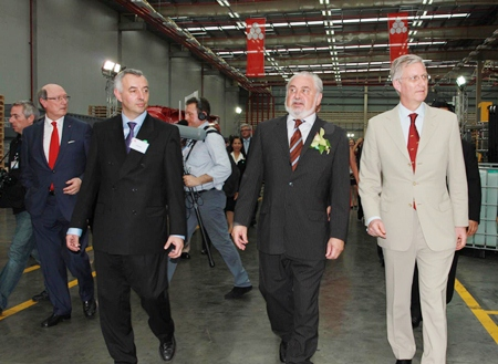 Crown Prince Philippe (right) and a delegation of Belgian officials and business leaders tour Rayong's Maptaput Industrial Estate.