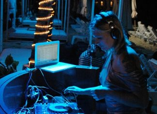 Russian DJ Olga Ola plays the dance music on the beach at Hotel G.