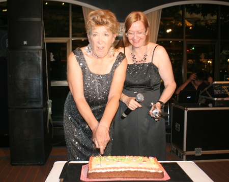 Outgoing and incoming presidents Ann Winfield and Helle Rantsen share a cake cutting.