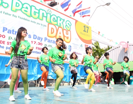"Children from Redemptorist Foundation perform some ""Irish"" dance moves outside Alcazar Theatre on St. Patrick's day before the parade began."