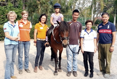(L to R) Sandra Cooper (riding therapist), Charlotte Weber, riding coach and instructor, Angela Navaraj, riding coach and instructor, Herb riding Tiffi, Akkasit Tiatrakul, riding coach and instructor (SEA Games gold medalist for Thailand), Vaewratt Kamonkon (owner of Horse Lovers Club Bangkok), and Suvich Prechaharn (father of Herb).