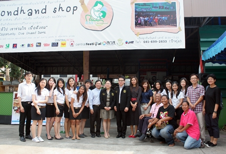 Students, honored guests and officials celebrate the opening of the new secondhand shop.