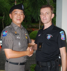 """The superintendent of Pattaya's tourist police, Lieutenant Colonel Aroon Promphan (left), has announced the appointment of Wayne Walton to be the new group leader of Pattaya's Foreign Tourist Police Assistants (FTPA).  Wayne, 45, has many years' experience of UK policing including UK Royal Protection, and additional experience in the private sector organizing Close Protection for various dignitaries. Wayne said, """"I am honoured to take over leadership of FTPA in Pattaya following the resignation of Rey Dominguez who will be spending more time in the USA.  I hope to involve many more people in FTPA in the future to make the team more dynamic and professional."""" He explained that the 45 member-strong FTPA had a priority to recruit more Russian-speaking members in view of the changing visitor profile on Walking Street. The role of the auxiliary FTPA is to assist the regular tourist police, principally at the mobile unit on Walking Street, dealing with general tourist questions as well as assisting with visitors' difficulties and helping to keep public order as and when necessary.  They also work with Thai tourist police volunteers. In recent years, FTPA has attempted to become more professional with a lengthy induction programme and regular ongoing training and meetings.  Applicants must possess a one year visa in Thailand and have police clearance from their home country.  There is a strict disciplinary code and a detailed manual of correct procedures.  Most FTPA have police, army or security backgrounds or have other relevant skills such as foreign language fluency or diplomatic experience. Barry Kenyon, the press officer said, """"Most people remember the famous TV series Big Trouble in Thailand, but FTPA has evolved in many ways since then.  Wayne has a big task ahead in ensuring the organization is progressive and up-to-date, but he's surely the right man for the job.  Pattaya is now attracting huge numbers of Russian, Indian and Chinese tourists and our structures nee"""