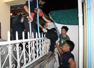 Rescue workers try to free the impaled woman from the iron fence, but in the end needed to cut the fence and transport her to the hospital with the pointed prong still in her leg.