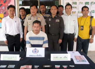 Sattahip and Royal Thai Navy officials captured Chatchai Udomzup (seated) for allegedly selling ya ba.