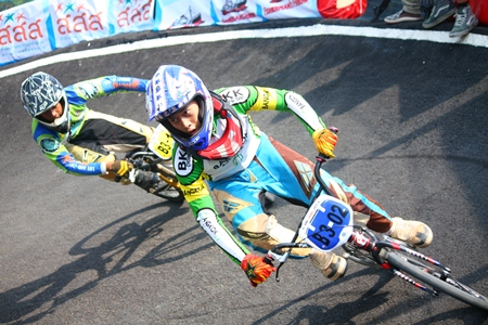 Taking a curve at high speed – all part of BMX racing.