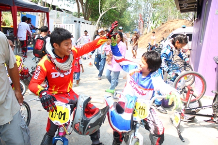 Senior and junior riders give encouragement to one another.