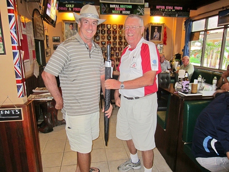Dick Warberg (right) presents the MBMG Group Golfer of the Month award to Mike Gaussa.