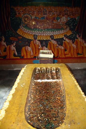 A replica of Buddha's footprint is highly worshipped at Wat Khao Phrabat.