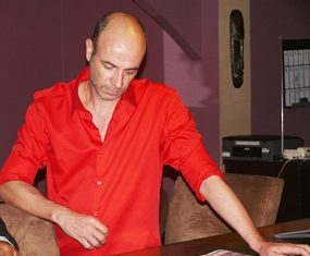 Parrot's Inn Bistro's owner Christophe peruses the Pattaya Mail.