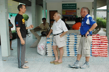 (L too R) Woody Underwood, Bernie Tuppin and Bill Freeman prepare to help deliver donated rice.