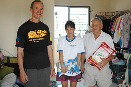 Woody and Bernie present rice presented to Nong Ice's mum.