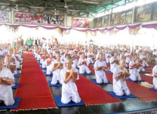 Sattahip youngsters join with hill tribe youths to enter the monkhood in honor of the royal family.