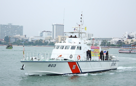 A Coast Guard vessel leads a parade of marine safety boats during the announcement of increased cooperation between marine police, marine departments, city hall, Sawang Boriboon and marine volunteers.