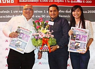 Kamolthep Malhotra, GM of Pattaya Mail Media Group, presents flowers to Volker Hellstern, MD of Hafele (Thailand) Limited, with Pawinee Kaewkert, during Hafele's 90th Anniversary celebration.