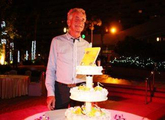 Gerard Lemmers enjoys his birthday cake.