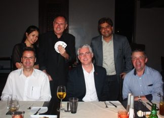 """Howard poses for a photo opportunity with Dueanpen """"Tuk"""" Thongsombut (Amari Orchid Pattaya assistant sales director), Tony Malhotra (deputy managing director of Pattaya Mail Media Group), Richard Margo (resident manager of Amari Orchid Resort), Brendan Daly (general manager of Amari Orchid Resort) and Paul Strachan from PMTV."""