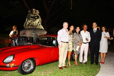 British Ambassador to Thailand Mark Kent (2nd right) joins friends around the centerpiece of the party: a classic E-Type Jaguar.