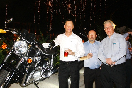 The Triumph motorcycle is a big hit with the male party goers.