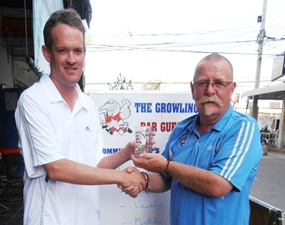 Brad Todd (left) receives the Monthly Mug from Peter Grey.