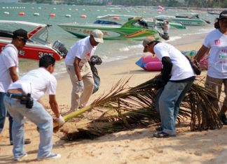 Neighborhoods looking better: Tune Hotel Pattaya staff remove litter and debris from Pattaya's beach front.