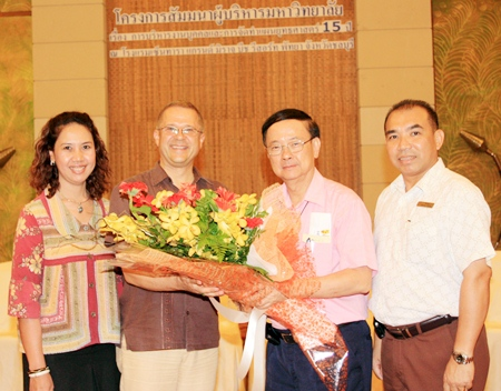 """Chulalongkorn University President Prof. Pirom Kamolratanakul (2nd right) presided over a seminar on """"15 Years Planning for Human Resources and Strategy Management"""" at the Centara Grand Mirage Beach Resort Pattaya recently. He was welcomed by GM Andre Brulhart (2nd left) together with Usa Pookpant (left), PR Manager and Wuthisak Pichayagan (right), Executive Assistant Manager - Food & Beverage."""