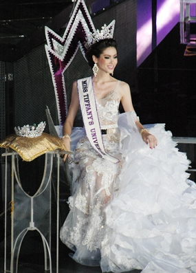 Last year's winner Panwilas Mongkol graciously makes her final entrance and exit as Miss Tiffany's Universe 2012.