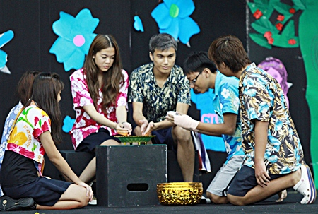 Secondary students stage a performance to explain the meaning of Songkran.