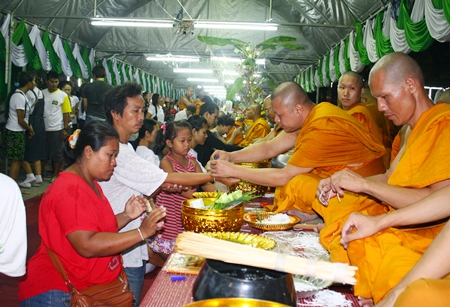 "Buddhists have their wrists wrapped in the auspicious ""sai sin"" to protect them from evil. Temples throughout the greater Pattaya region were filled with Buddhists making merit on Visakha Bucha Day - the triple occasion of the birth of Buddha, the day of his enlightenment and his ascension to Nirvana."