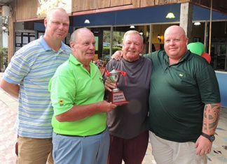 Bob Lindborg presents the winning pairs trophy to Joe Mooneyham, with the runners up Mark Riggall (left) and Scotty Qua (right).