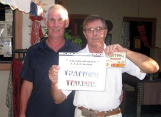 Tuesday winner Mike Gerrard (right) receives his prize standing next to Kevin Bird.