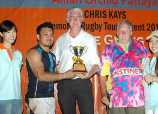 Brendan Daly, General Manager of the Amari Orchid Resort Pattaya (center) presents the Cup to the captain of the Thai Barbarians (2nd left) at the conclusion of the 2013 Amari Orchid Pattaya Chris Kays Memorial Rugby Tournament at Horseshoe Point, Sunday, May 5.