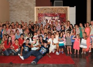 """Nitichai Nakornmuang (front row, centre), leisure manager of Centara Grand Mirage Beach Resort Pattaya invited more than 80 members and their families to a """"Fitness & Spa Get Together Party"""" at Mirage Roof-Garden on the resort's 19th floor recently."""