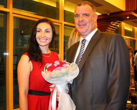 Joe Cox (right), MD of Defence International Security Services, who celebrated his birthday on the same evening as the Pattaya football dinner is congratulated by Irena De Ribas of The Russian Real Estate Magazine.