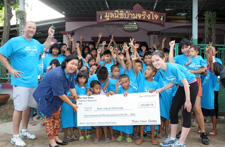"Lisa Koenig (front, right) presents 250,000 baht raised through her ""Thai Your Shoes"" organization to Ban Jing Jai."
