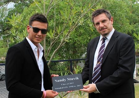 GIS Principal Dr Stuart Tasker presents Sandy with a special plaque.