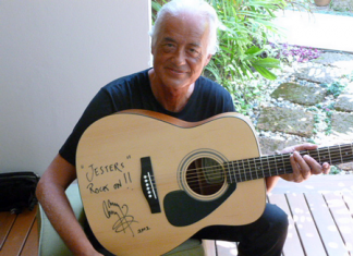 Jimmy Page displays his guitar, which was auctioned off at last year's Gala Party Night.