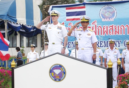Rear Adm. William C. McQuilkin (left), commander of U.S. Naval Forces Korea, and Rear Adm. Paithoon Prasopsin (right), commander of the Royal Thai Navy's Frigate Squadron 2, salute the troops during the opening ceremonies for CARAT 2013.