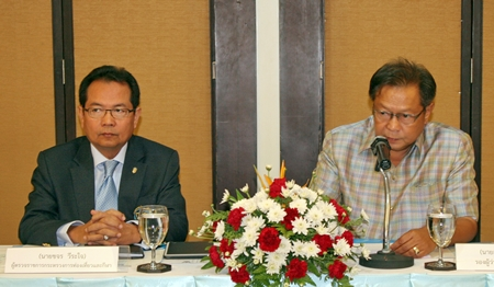 Khajorn Weerachai (left), from the Ministry of Tourism and Sports, and Deputy Governor Adisak Thepass preside over the meeting.