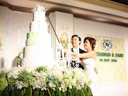 The newlywed bride and groom cut wedding cake.