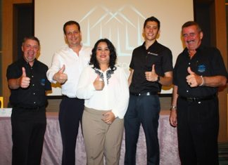 Paul Strachan (left) and John Collingbourne (right) are joined by Paul Sutton (2nd left) from Powerhouse Development, May Watson (center) from Matrix and Lorenzo Joaquin (2nd right) from Global Top Group.