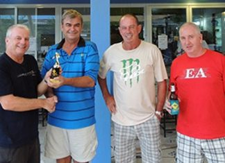 General Jack (2nd left) presents the winning monthly trophy to Sel Wegner (left), with Paul Bourke and Steve Milne looking on.
